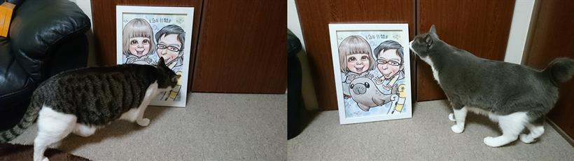 飼い主と彼女の絵を匂いに来る愛猫ミミとモコ